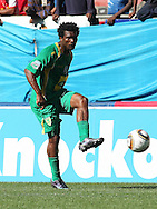 CAPE TOWN, SOUTH AFRICA - 28 MARCH 2010, Mzivukile Tom of Golden Arrows sends a pass up field  during the Telkom Knock Out match between Ajax Cape Town and Golden Arrows held at Newlands Stadium in Cape Town, South Africa..Photo by: Shaun Roy/Sportzpics