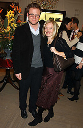 TV presenter MARIELLA FROSTRUP and her husband JASON McCUE at a party hosted by the Gussalli Beretta family to celebrate the opening of the new Beretta store, 36 St.James's Street, London SW1 on 10th January 2006.<br />