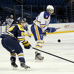 Buffalo, NY - Feb 20 : Ontario Junior Hockey League game action between the Buffalo Junior Sabres and the Whitby Fury, Patrick McAuliffe #25 of the Whitby Fury Hockey Club looks to knock down a pass by Maxwell Mikowski #18 of the Buffalo Junior Sabres Hockey Club. (Photo By Timothy T. Ludwig / OHJL Images)