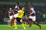 Burton Albion defender Kyle McFadzean (5) controls the ball away from Aston Villa midfielder Albert Adomah (37) and Aston Villa striker Keinan Davis (39) during the EFL Sky Bet Championship match between Burton Albion and Aston Villa at the Pirelli Stadium, Burton upon Trent, England on 26 September 2017. Photo by Richard Holmes.