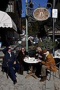Italy, Madonna di Campiglio,  capuccino at Caffè Campiglio, Piazza Righi.