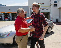 Paul Gaudet Jr. is thanked by Kyle Bigler for his new wheels a 2005 Honda Accord from AutoServe of Tilton on Tuesday morning.   (Karen Bobotas/for the Laconia Daily Sun)