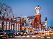 A row of cars passes under several of the tows landmarks, including the