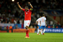 TOULOUSE, FRANCE - Monday, June 20, 2016: Wales captain Ashley Williams celebrates his side's 3-0 victory over Russia and qualification for the knock-out stage during the final Group B UEFA Euro 2016 Championship match at Stadium de Toulouse. (Pic by David Rawcliffe/Propaganda)