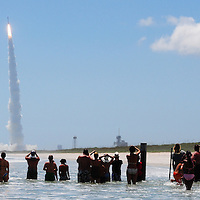 Andrew Knapp, FLORIDA TODAY -- Aug. 5, 2011 -- People watch the launch of NASA's Juno spacecraft aboard an Atlas V rocket Friday afternoon at Playalinda Beach, about 4 miles from the launch pad.