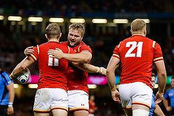 Wales Winger Hallam Amos celebrates scoring a try with replacement Tomas Francis - Mandatory byline: Rogan Thomson/JMP - 07966 386802 - 20/09/2015 - RUGBY UNION - Millennium Stadium - Cardiff, Wales - Wales v Uruguay - Rugby World Cup 2015 Pool A.
