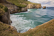 A long-exposure of the incoming tide at Tunnel Beach, Dunedin, New Zealand.