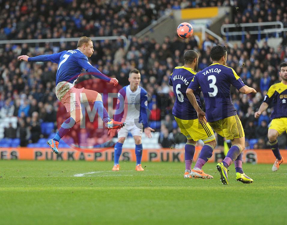 Birmingham City's Chris Burke shoots at goal. - Photo mandatory by-line: Alex James/JMP - Tel: Mobile: 07966 386802 25/01/2014 - SPORT - FOOTBALL - St Andrew's - Birmingham - Birmingham City v Swansea City - FA Cup - Forth Round