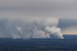 October 9, 2018 - Chernigov, Ukraine - Smoke rises after a fire and explosions hit the Ukrainian defence ministry ammunition depot in the eastern Chernigov region, Ukraine October 9, 2018. (Credit Image: © Maxym Marusenko/NurPhoto via ZUMA Press)