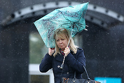 © Licensed to London News Pictures. 08/02/2015. Huddersfield, UK. A woman struggles with her umbrella in Huddersfield, West Yorkshire, as the town is battered by Storm Imogen. The UK is set to see more bad weather with high winds and flood warnings in place causing chaos and disruption to travel. Photo credit : Ian Hinchliffe/LNP