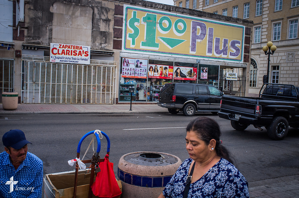 Shoppers gather outside a Hispanic grocery store in Brownsville, Texas, early Sunday, April 17, 2016. The border town is culturally infused with both Anglo and Hispanic influences, with emblematic American architecture. Many Mexican residents purchase goods in Brownsville and walk back through the Mexican border. LCMS Communications/Erik M. Lunsford