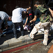 August 10, 2012 - Aleppo, Syria: A group of men carry the dead body of a man killed minutes earlier by heavy shelling from the Syrian Army against a bakery in the residential area of Tariq Al-Bab in central Aleppo. At least 12 people have died and more the 20 got injured during the attack...The Syrian Army have in the past week increased their attacks on residential neighborhoods where Free Syria Army rebel fights have their positions in Syria's commercial capital, Aleppo. (Paulo Nunes dos Santos/Polaris)