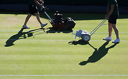 WIMBLEDON - GB -  4th July 2016: The Wimbledon Tennis Championship continues at the All England Lawn Tennis Club in S.E. London.<br /> <br /> The courts are prepared early morning. Line Painting, grass cutting and grass vacuuming.<br /> <br /> Photo by Ian Jones