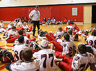 Aplington-Parkersburg head coach Ed Thomas talks to his team before their game at Turkey Valley High School in Jackson Junction, Iowa on October 3, 2008. (Stephen Mally / Special to The Denver Post)