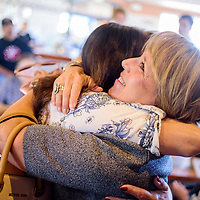 New Mexico gubernatorial candidate Michele Lujan Grisham hugs a supporter during a campaign meet and greet at Kiva Cafe in Milan Monday.