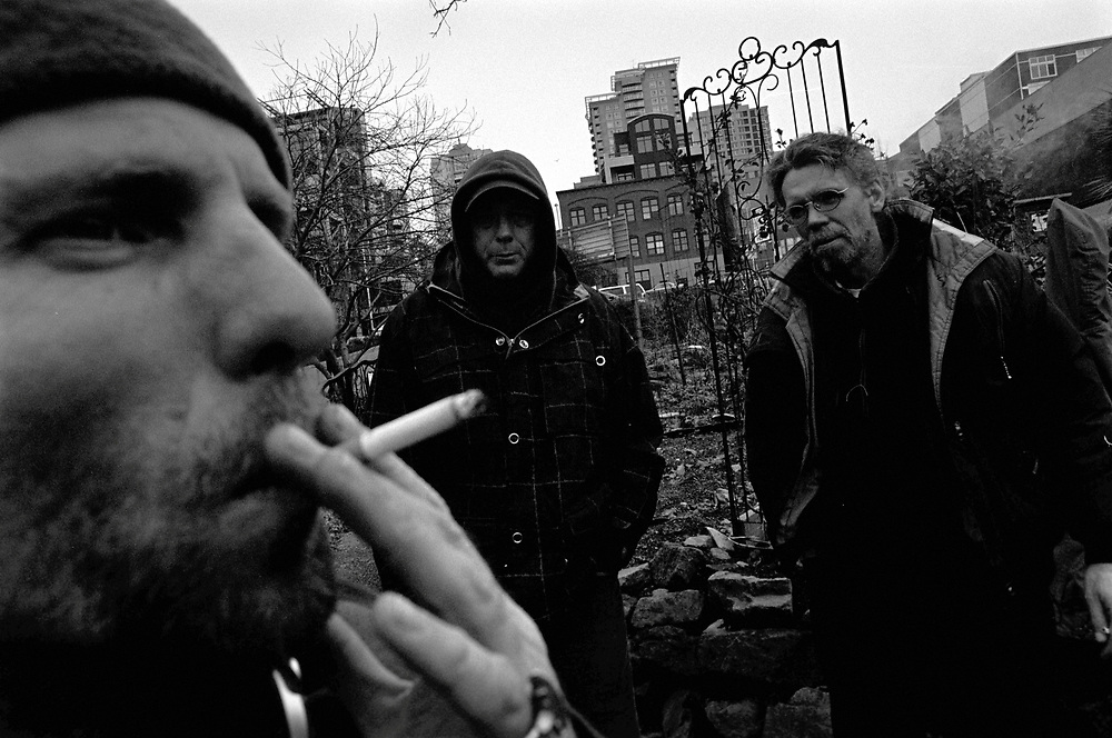 Timothy Leary Byrnes, foreground, smokes a cigarette in the Belltown P-Patch while waiting for more friends to arrive before smoking marijuana as a group. Homeless since the '80s and a native of San Francisco, having lived in Haight-Ashbury, Byrnes is a fixture in the local homeless community.