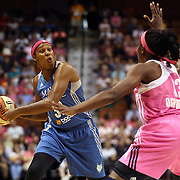 Rebekkah Brunson, (left), Minnesota Lynx, defended by Chiney Ogwumike, Connecticut Sun, during the Connecticut Sun Vs Minnesota Lynx, WNBA regular season game at Mohegan Sun Arena, Uncasville, Connecticut, USA. 27th July 2014. Photo Tim Clayton