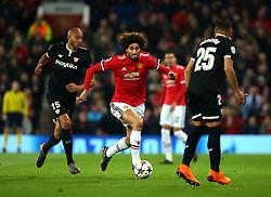 Marouane Fellaini of Manchester United goes past Steven N'Zonzi of Sevilla - Mandatory by-line: Robbie Stephenson/JMP - 13/03/2018 - FOOTBALL - Old Trafford - Manchester, England - Manchester United v Sevilla - UEFA Champions League Round of 16 2nd Leg