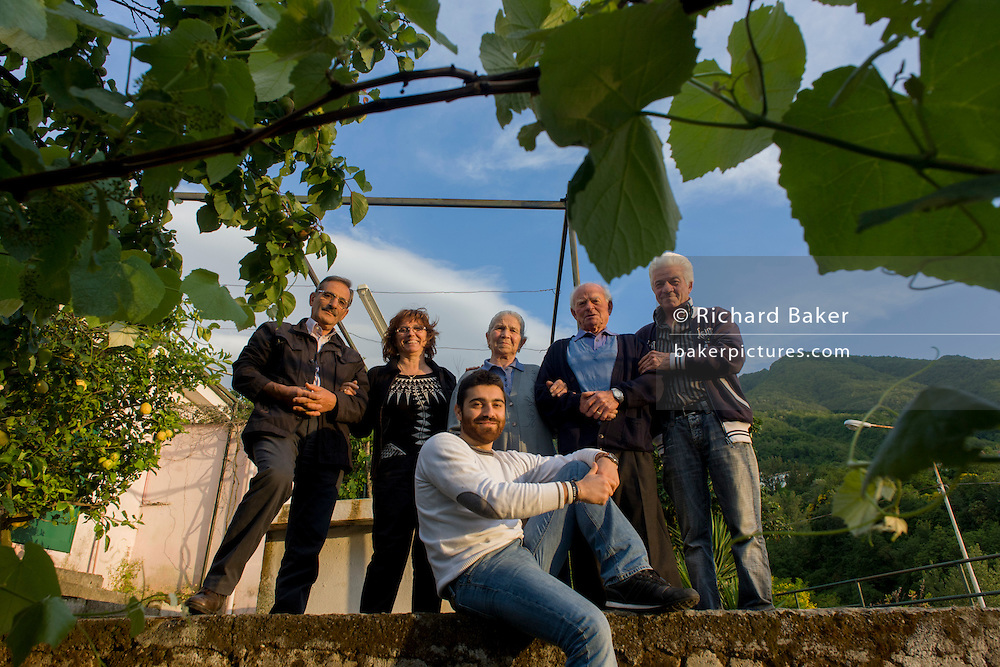 Baldassare and Felicia De Simons and family surrounded by lemons in their garden in the village of Somma Vesuviana, in the Red (evacuation) Zone on the western slope of Vesvius, Somma, Italy. <br /> <br /> From the chapter entitled 'Under the Volcano' and from the book 'Risk Wise: Nine Everyday Adventures' by Polly Morland (Allianz, The School of Life, Profile Books, 2015).