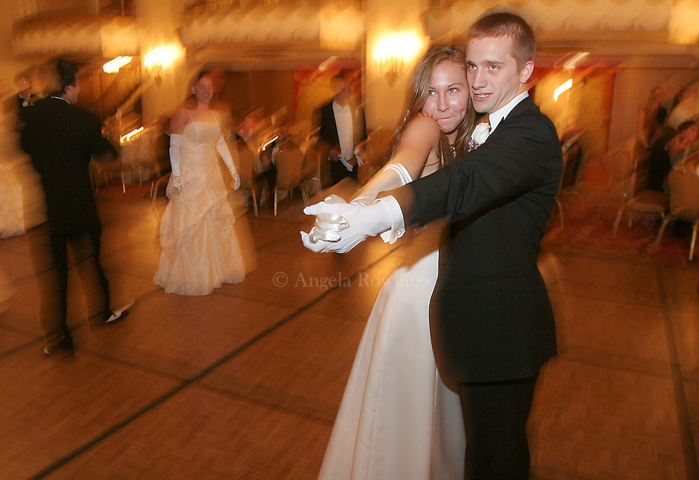 06/16/06 Boston, MA-- Amanda McGuire, 18, of Beacon Hill, dances with one of her escorts during the Boston Cotillion at the Park Plaza.  (061606cotillionar11, saved in adv news, Staff Photo by Angela Rowlings)