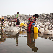 At the end of the dry season the river outside Delafagi has almost dried up and its one of the only water sources left at this time of the year.  Action for Integrated Sustainable Development Association (AISDA) work in the AFAR region of Eastern Ethiopia, based in Delafagi. The Afars practise an old tradition of Female Genital Mutilation where the baby girls has her clitoris and labia cut away and her vagina sewn up. The day before her wedding day the girl is un-stiched ready for marriage. Its a brutal and barbaric tradition which AISDA is challenging with great effect, now more than a hundred girls in Dowe district have been saved from the knife and AISDA is now rolling out the scheme in Delafagi. Delafagi is where the oldest ever human remains have been found, the found is thought to be 4.5 mill years old.