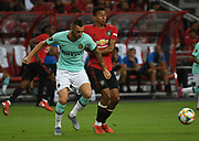 Inter Milan's Marcele Brazovic tussles with Manchester United's Jesse Lingard during an International Champions Cup game won by Manchester United 1-0, Saturday, July 20, 2019, in Singapore. (Kim Teo/Image of Sport)