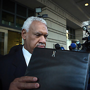 "WASHINGTON, DC - MAR 10: Jeffrey E. Thompson is thronged by journalists as he leaves the U.S. District Court of the District of Columbia, March 10, 2014 in Washington, DC, following his hearing on his behind the scenes campaign efforts and funding for Mayor Gray four years ago. Associates have said in court that Thompson secretly funneled more than $650,000 to a ""shadow campaign"" on Gray's behalf. Seven people connected to Thompson or affiliated with Gray's 2010 campaign have pleaded guilty in federal court in the past two years and have outlined Thompson's alleged efforts to subvert local and federal campaign finance laws. (Photo by Evelyn Hockstein/For The Washington Post)"
