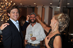 Left to right, CHARLES GOODE, JACK BROCKWAY and his mother LINDY BROCKWAY at the Goode & Son collection showcase in the E Wow Suite, W London, Leicester Square, London on 6th October 2011.