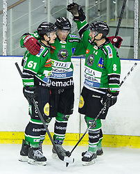 23.01.2015, Hala Tivoli, Ljubljana, SLO, EBEL, HDD Telemach Olimpija Ljubljana vs HC Znojmo Orli, 42. Runde, in picture Sebastijan Hadzic (HDD Telemach Olimpija, #30) celebrates with Luka Kalan and Marvin Degon after scoring his first goal in EBEL league during the Erste Bank Icehockey League 42. Round between HDD Telemach Olimpija Ljubljana and HC Znojmo Orli at the Hala Tivoli, Ljubljana, Slovenia on 2015/01/23. Photo by Morgan Kristan / Sportida