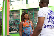 Chika Chukwu talking to the manager of a local petrol station that bought paint from her. The manager saw the colours in her office and copied the look on his petrol station.<br /> <br /> Chika set up and runs Decency Paints, which sells paint.<br /> <br /> Chika set up her business just over a year ago. The biggest thing that she has learnt from the Youth for Technology training is about managing and investing money. She used to think you needed lots of money to grow the business but now understand you can invest small amounts too.
