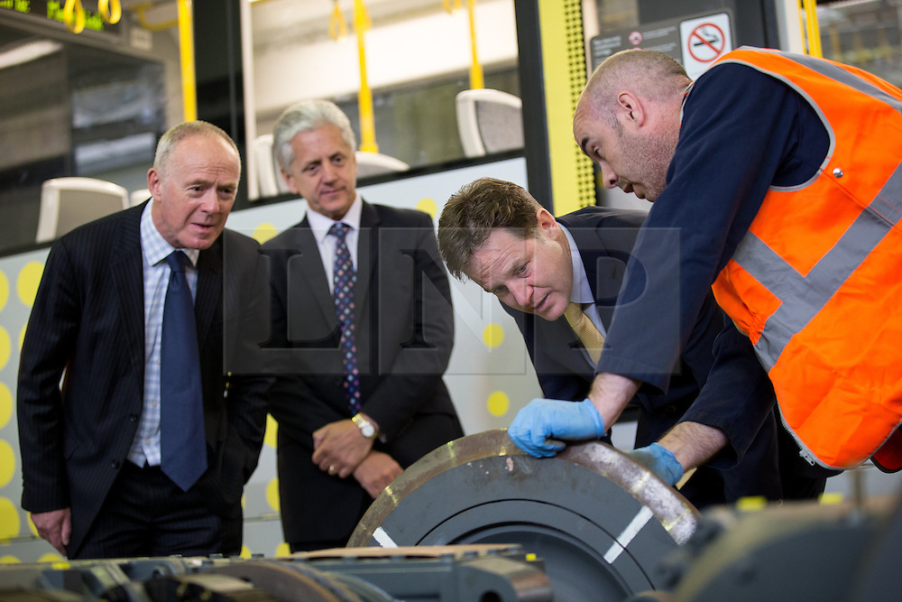 © Licensed to London News Pictures . 07/07/2014 . Manchester , UK . L-R Sir Richard Leese ( Leader of Manchester City Council ) , Mike Blackburn ( Chairman of the Local Enterprise Partnership ) , Nick Clegg MP ( Deputy Prime Minister ) and a member of staff from Metrolink , talking about tram wheels . Nick Clegg launches the British Government's local Growth Deals this morning (7th July 2014) at Metrolink Tram depot in Trafford , Manchester . The Government says that £12 billion will be invested in local business , training and infrastructure projects .  Photo credit : Joel Goodman/LNP