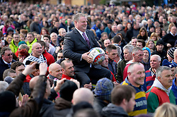 © London News Pictures. 04/03/2014. Ashbourne, UK. Retired firefighter Stuart Lee holds the match ball. Two teams, the Up'Ards and the Down'Ards, fight for the ball during the first day of the Royal Shrovetide Football match in Ashbourne, Derbyshire. For two days, over Shrove Tuesday and Ash Wednesday, hundreds of participants battle it out in a 'no rules' game dating back to the 17th Century where the aim is to get a ball into one of two goals that are positioned three miles apart at either end of Ashboune. Photo credit: Ben Cawthra/LNP