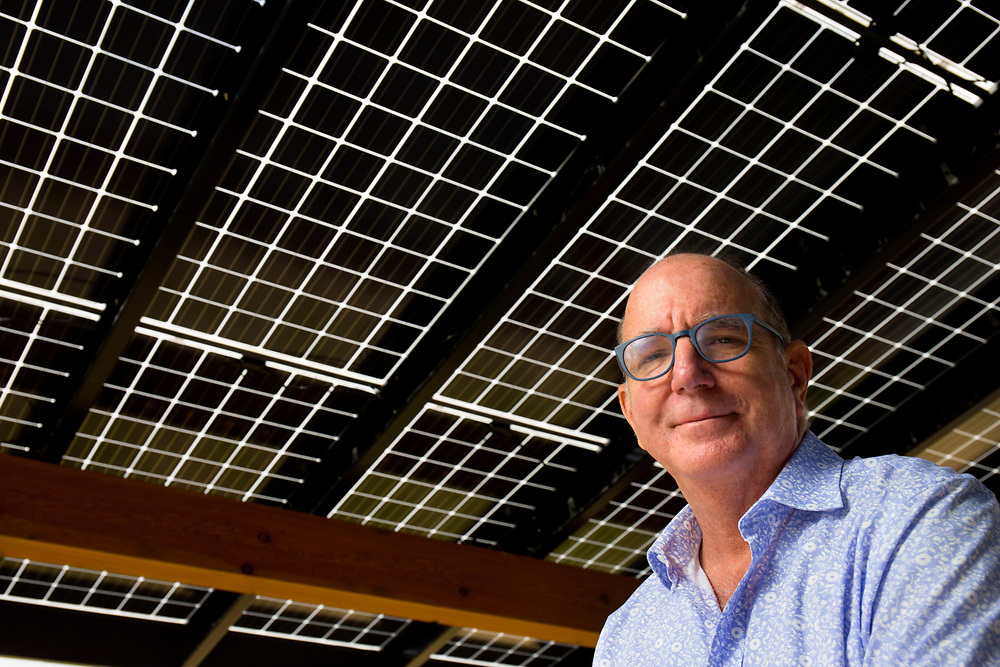 SunCommon Co-President Duane Peterson below bi-facial solar panels, which absorb energy on both sides, in Waterbury, Vt., on May 11, 2017. Peterson and James Moore started the company in 2012 and the business has grown from 16 employees to over 70. (Photo by Geoff Hansen)