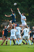 Highlanders player Elliot Dixon (L) challenges for the ball during the line-out with Racing 92 player Julien Brugnaut Rugby union match The Highlanders vs French team Racing 92
