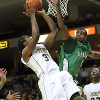 Central Florida guard/forward Isaiah Sykes (32) shoots past Marshall forward Antonio Haymon (1) during a Conference USA NCAA basketball game between the Marshall Thundering Herd and the Central Florida Knights at the UCF Arena on January 5, 2011 in Orlando, Florida. Central Florida won the game 65-58 and extended their record to 14-0.  (AP Photo/Alex Menendez)