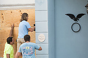 Workers secure plywood covering on a historic building on Broad Street in preparation for Hurricane Irma September 8, 2017 in Charleston, South Carolina. Imra is expected to spare the Charleston area but hurricane preparations continue as Irma leaves a path of destruction across the Caribbean.