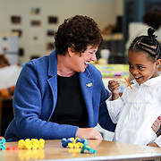 Kathy Ryg, Voices for Illinois Children President, interacts with children at the Marillac House in Chicago, Friday, November 5, 2010. Photo by J. Geil.