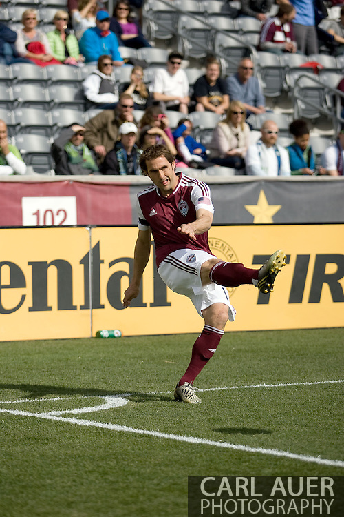 April 20th, 2013 Commerce City, CO - Colorado Rapids midfielder Brian Mullan (11) attempts a corner kick attempt in the first half of action of the MLS match between the Seattle Sounders FC and the Colorado Rapids at Dick's Sporting Goods Park in Commerce City, CO