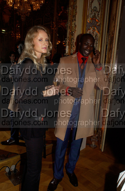 Ozwald Boateng, Givenchy after-party at Musee Bacarrat, Couture week, Paris, 20 January 2004. © Copyright Photograph by Dafydd Jones 66 Stockwell Park Rd. London SW9 0DA Tel 020 7733 0108 www.dafjones.com