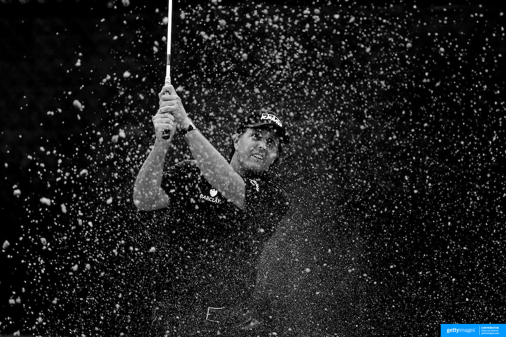 Phil Mickelson hits out of the sand trap on the 13th hole during the second round of theThe Barclays Golf Tournament at The Ridgewood Country Club, Paramus, New Jersey, USA. 22nd August 2014. Photo Tim Clayton