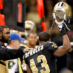 January 1, 2012; New Orleans, LA, USA; New Orleans Saints running back Darren Sproles (43) raises his helmet to acknowledge the crowd as running back Mark Ingram (28) congratulates him on the sideline during the fourth quarter after Sproles broke the NFL's all-purpose yardage record formerly held by Derrick Mason against the Carolina Panthers at the Mercedes-Benz Superdome. The Saints defeated the Panthers 45-17. Mandatory Credit: Derick E. Hingle-US PRESSWIRE
