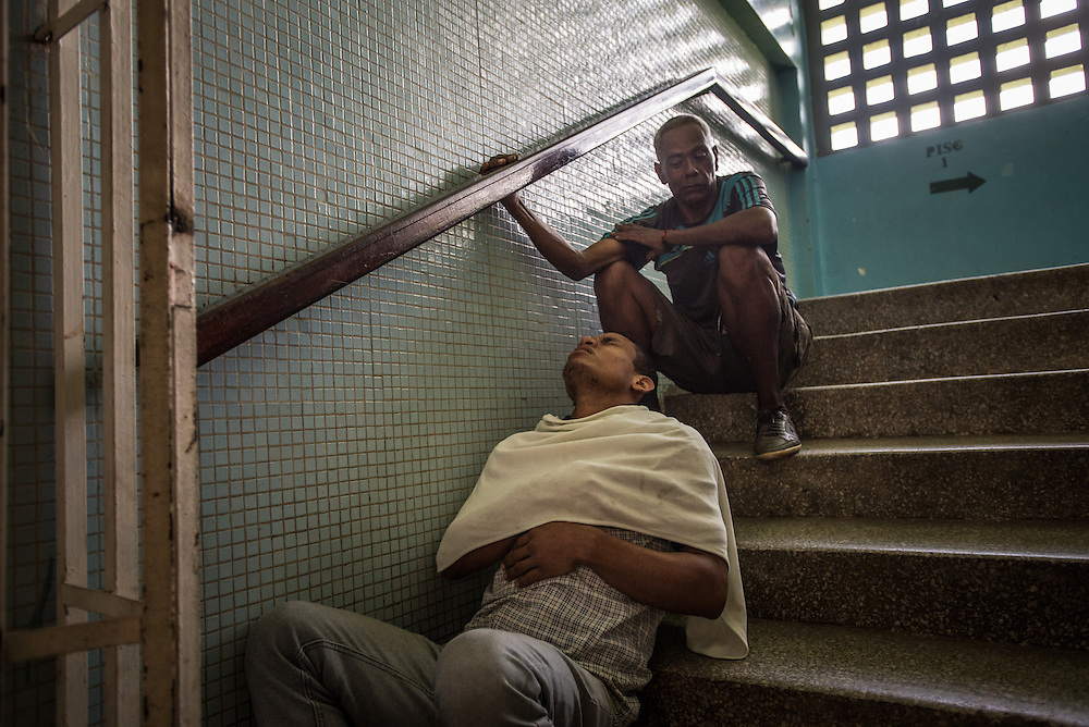 "SAN FELIX, VENEZUELA - MAY 24, 2016: A gold miner shakes uncontrollably from a high fever while waiting to be seen by a doctor. He was one of hundreds of people overflowing a small clinic, all with symptoms of malaria: fevers, icy chills and uncontrollable tremors. A handful of doctors and hospital staff tried their best to test each patient for malaria: pricking their ears for a blood sample in a room without air conditioning and no lights because the government had cut power to save electricity. There were no medicines to be distributed, because the health ministry had not delivered any this day. Frustrated patients protested in the street outside of the hospital pleading for malaria medicine to be delivered.  Dr. Griselda Bello waved her hands helplessly to tell yet another patient that there was no medicine that day. ""Come back tomorrow at 10 a.m.,"" she said. ""My God,"" the patient said. ""Someone might die by then."" ""Indeed they might,"" she said.  The spread of malaria in Venezuela is a state secret. Since 2007, the government has not submitted annual epidemiological reports on the disease and says there is no epidemic. But the most recent report, obtained by The New York Times from Venezuelan doctors involved in compiling it, confirms a surge is underway.  Last year, malaria cases rose 56% to 136,000 cases, the highest level in 75 years when the state began efforts to eradicate the disease, according to the report. Malaria has cut a wide swath through the country with cases now present in half of its 23 states. And among the strains present here is Plasmodim falciparum, the most fatal and severe form of the disease.   PHOTO: Meridith Kohut for The New York Times"
