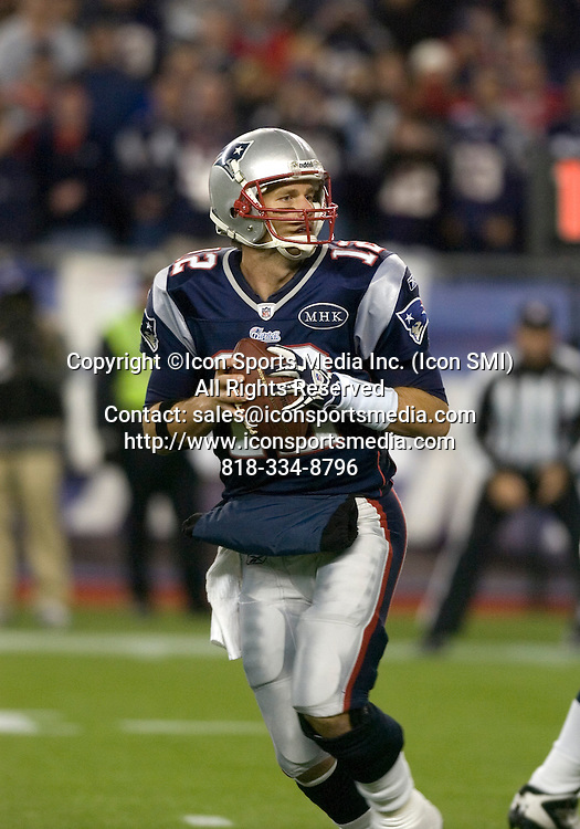 6 November 2011.  Patriot Quarterback Tom Brady (12) drops back to pass in the fourth quarter.   The New York Giants beat the New England Patriots 24 to 20 in Gillette Stadium in Foxboro on a Sunday afternoon game.