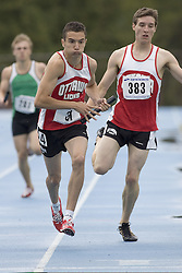 Benazzouz, Reda taking the stick from Spaull, Graham competing in the 4x400m relay at the 2007 OTFA Junior-Senior Championships in Ottawa.