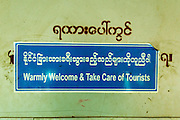 15 JUNE 2013 - YANGON, MYANMAR:  A sign on the Yangon Circular Train. The Yangon Circular Railway is the local commuter rail network that serves the Yangon metropolitan area. Operated by Myanmar Railways, the 45.9-kilometre (28.5mi) 39-station loop system connects satellite towns and suburban areas to the city. The railway has about 200 coaches, runs 20 times and sells 100,000 to 150,000 tickets daily. The loop, which takes about three hours to complete, is a popular for tourists to see a cross section of life in Yangon. The trains from 3:45 am to 10:15 pm daily. The cost of a ticket for a distance of 15 miles is ten kyats (~nine US cents), and that for over 15 miles is twenty kyats (~18 US cents). Foreigners pay 1 USD (Kyat not accepted), regardless of the length of the journey.     PHOTO BY JACK KURTZ