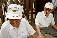 August 15, 2016, Tokyo, Japan: This is 89 y/o Te Iwade of Hokkaido (left), a former WW II Zero pilot, and 89 y/o Shoji Hayakawa of Nagano Prefecture (right), a former Navy pilot during WW II. They were visiting Yasukuni Shrine today, the 71st anniversary of the end of World War II. Here tens of thousand came to pay their respects for Japan's war dead at Yasukuni, the national Shinto shrine where nearly 2.5 million war dead from the past 150 years are enshrined. Visits to Yasukuni by top Japanese politicians continue to outrage China and South Korea because it honors 14 World War II class A war criminals who are also enshrined there. Even so, dozens of Japanese lawmakers and 2 cabinet ministers visited Yasukuni Shrine today, while PM Shinzo Abe sent a ritual cash offering via his emissary. (Torin Boyd/Polaris).