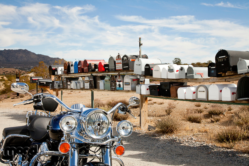 Motorcycle in front of rural mailboxes