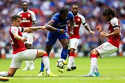Michy Batshuayi of Chelsea is challenged by Granit Xhaka of Arsenal - Rogan Thomson/JMP - 06/08/2017 - FOOTBALL - Wembley Stadium - London, England - Arsenal v Chelsea - FA Community Shield.