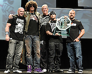 "LAS VEGAS, NEVADA, JULY 10, 2009: (L to R) UFC president Dana White, Tim Katz, Marc Kreiner, Dan Caldwell and UFC CEO Lorenzo Fertitta pose on stage with a plaque for the late Charles Lewis Jr. after his posthumous induction in to the UFC's ""Hall of Fame"" during the first UFC Fan Expo inside the Mandalay Bay Convention Centre in Las Vegas, Nevada"