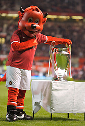 Manchester, England - Tuesday, March 13, 2007: Manchester United's mascot Fred the Red poses next to the European Champions' Cup, which United won in 1999, before the UEFA Celebration Match against a Europe XI. (Pic by David Rawcliffe/Propaganda)